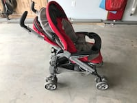 baby's red and black stroller Calgary, T3E 3M1