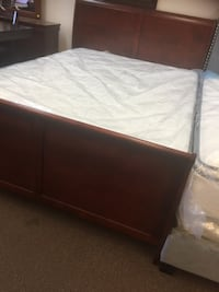 brown wooden bed frame with white mattress Houston, 77036