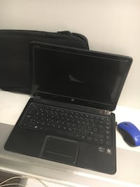 black laptop computer with charger Toronto, M6E 2H7
