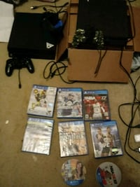 Two black Sony PS4 Slim units 2 controllers games Folcroft, 19032