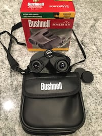 Bushnell Binoculars new with bag strap ultra high power