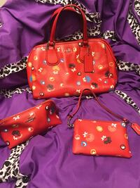 Women's red Coach bag, wristlet, and make-up bag...has long leather strap. Des Moines, 50311