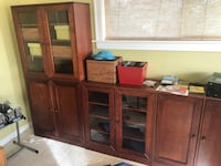 brown wooden TV hutch with flat screen television St. Pete Beach, 33706