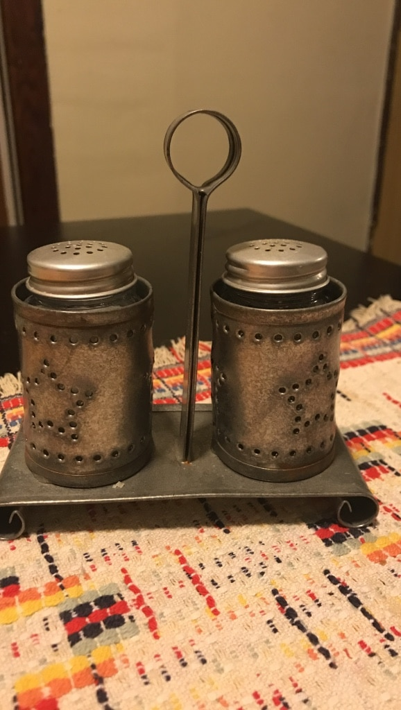 Salt and pepper shakers in carrier
