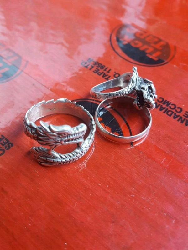two silver and red rings
