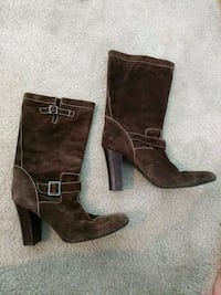 pair of women's brown leather Calvin Klein boots