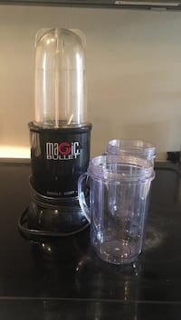 Magic bullet with two smoothie cup attachments