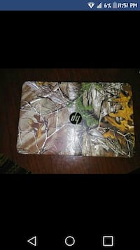 green, brown and white RealTree HP laptop computer