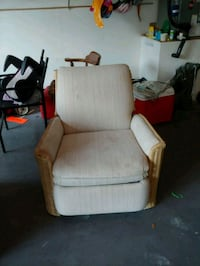 brown wooden framed white padded armchair