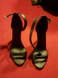 pair of black leather open-toe heeled sandals Calgary, T2A