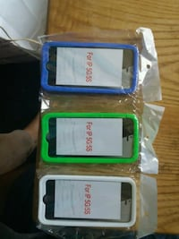 three assorted-color iPhone cases