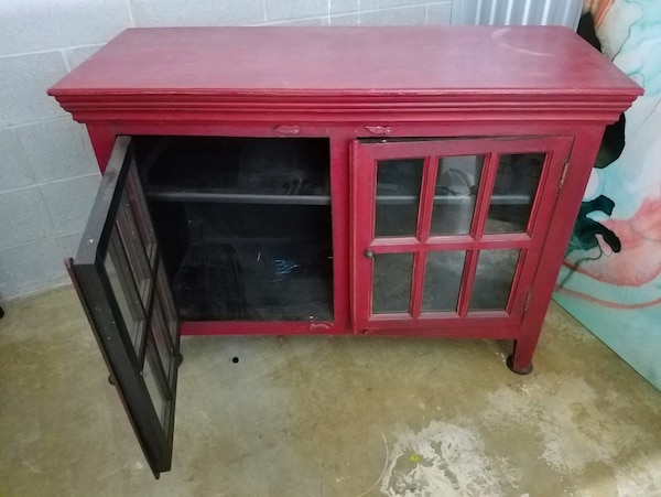 red wooden framed glass cabinet