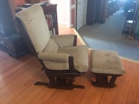 Brown wooden frame tan padded glider chair Washington, 20003