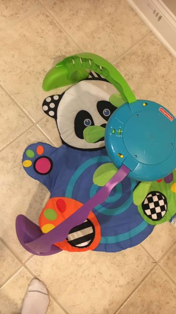 Baby's green, blue, and purple fisher-price crib mobile
