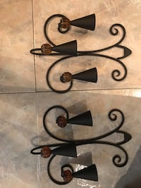 black metal candle holder and candle holder