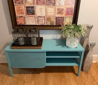 2 teal storage units with sliding doors - multifunctional for $100.00