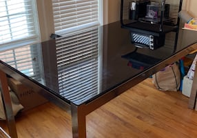 Black glass top table with silver frame
