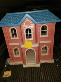 red and blue plastic dollhouse