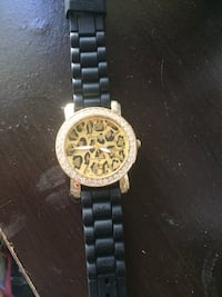 round gold chronograph watch with black link bracelet