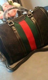 black, red, and green leather handbag Laval, H7W