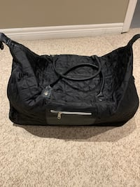 Black tote bag with wheels and zipper