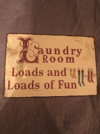 Metal laundry room sign