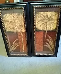 two black-framed coconut trees paintings