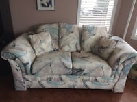 gray and blue fabric 3-seat sofa