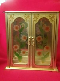 Jewelry.  display cabinet ,brass and glass