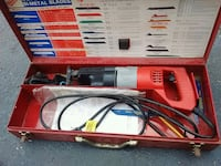 red and gray corded power tool Pensacola, 32504