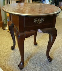 round brown wooden single drawer end table