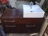 rectangular brown wooden 4-drawer table with white ceramic sink
