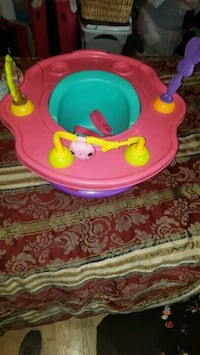 baby's pink and green activity saucer 2218 mi
