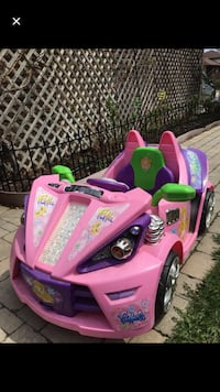 Pink and purple ride on toy car