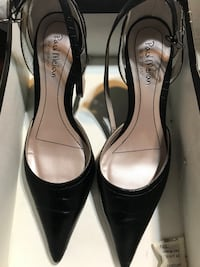 black leather pointed-toe pumps