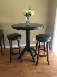round black wooden table with two chairs Orlando, 32821