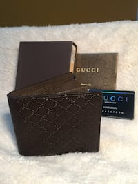 Beautiful dark brown leather wallet in box 539 km