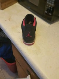 unpaired black and red Nike slide sandal Myrtle Beach, 29577
