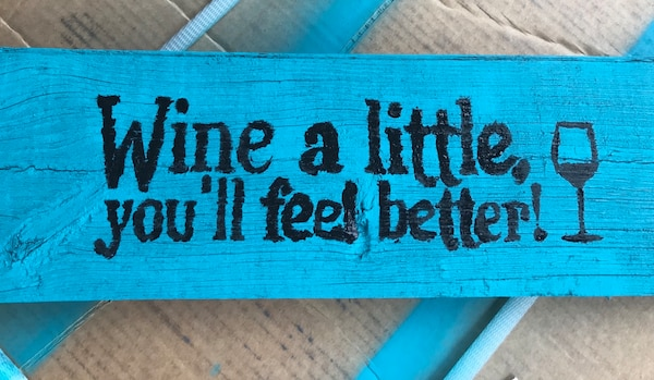 wine a little text on blue board