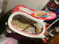 baby's white and pink bouncer 298 mi