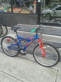 blue and red full-suspension bike