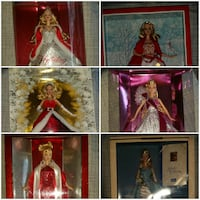13 Holiday Edition Barbies. New in box.