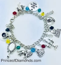Silver coloured Disney Beauty & the Beast charm bracelet Brampton, L6R 1X5