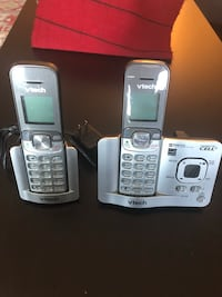 two gray Vtech home phones