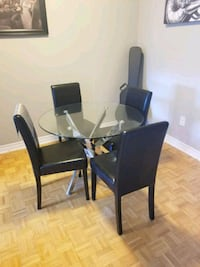 Round glass top table with four chairs dinin Brampton, L6Z 1C8