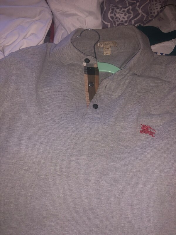 burberry polos size MED all buttons work no rips tears or nothing