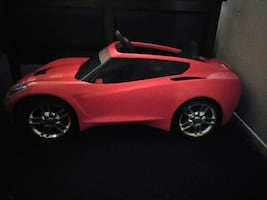 black and red ride on toy car