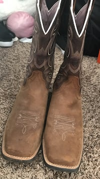 pair of brown leather square-toe cowboy boots