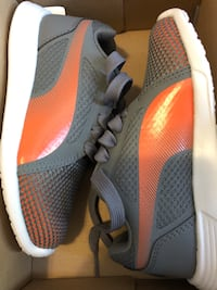 Pair of gray nike running shoes Montréal, H3W 2G1
