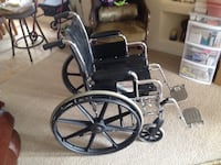 Black and gray wheelchair with black metal frame PHOENIX